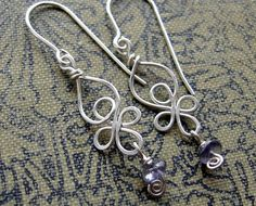 Little Celtic Knot Sterling Silver and Iolite Earrings - Celtic Jewelry-Dangle Earrings - Silver Wire Earrings-Celtic Earrings. $24.00, via Etsy.