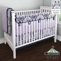 Crib bedding in Navy and Lavender Ikat Damask, Solid Lilac, Solid Navy Minky, Solid Navy. Created using the Nursery Designer® by Carousel Designs where you mix and match from hundreds of fabrics to create your own unique baby bedding. #carouseldesigns