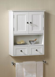 Charm and practicality come together in perfect harmony with this wall cabinet. It adds storage to any space with its two Nantucket-style doors and two pullout drawers, along with its open display shelf. Its perfect for the bathroom and beyond! Wall Mounted Display Cabinets, Wall Storage Cabinets, Wall Mounted Bathroom Cabinets, Bathroom Flooring, Bathroom Furniture, Bathroom Medicine Cabinet, Cabinet Drawers, Glass Shelves, Bathroom Cabinets Over Toilet