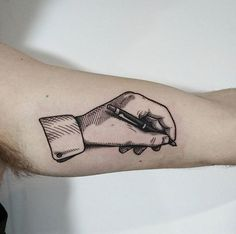 Fine line hand holding pen by Nick Whybrow @ Jayne Doe in Hornchurch London