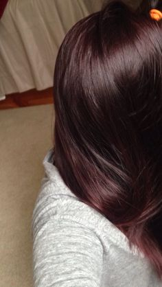 dark plum brown... Dont like red but this plum is nice!