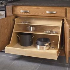 KraftMaid's customizable Harmony base pot and pan organizer keeps everything in its place, while offering easy access to cooking essentials. | Photo: Courtesy of KraftMaid | thisoldhouse.com
