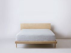 Solid Ash bed frame with brass hardware details. Making use of simple woodworking techniques, the Simple Collection offers purity of material, form and function.