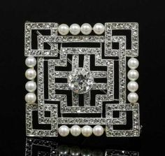 A 1920s silvery metal mounted diamond and pearl set square geometric pattern brooch, the centre set with an old cut diamond of approximately 1ct, contained within fine borders channel set with one hundred and eighty rose cut diamonds, bordered to either side by four small pearls,