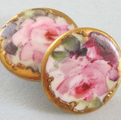 2 Antique Porcelain buttons with gilt trim.