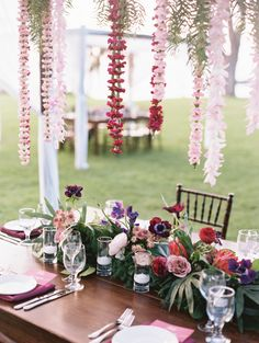 Tropical hanging leis: http://www.stylemepretty.com/destination-weddings/hawaii-weddings/2016/05/19/this-hawaiian-wedding-is-what-destination-wedding-dreams-are-made-of/ | Photography: Wendy Laurel - http://www.wendylaurel.com/