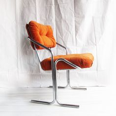 Ok, so I just found 4 chairs at a a garage sale for $3 each. This1960s Vintage Chair now featured on Fab, has a chrome frame also, so I think I will reupholster them to have puffy pillows instead of a flat surface.
