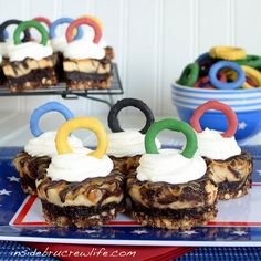 Coat round pretzels in candy coating tinted with food coloring. Easy Olympic rings!
