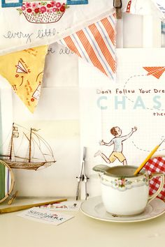 I love Sarah Jane Studios. Especially her At Sea fabric line and her scrapbooking papers.