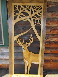 "Lodge Style Screen Door featuring ""Buck Shot"" with antlers that are 3-D against the branch backdrop."