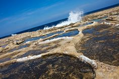 Waves crash into the salt pans