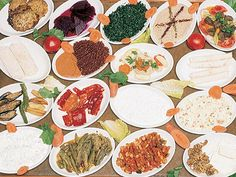 "Turkish meze often consist of beyaz peynir (literally ""white cheese""), kavun (sliced ripe melon), acılı ezme (hot pepper paste often with walnuts), haydari (thick strained yoghurt like the Levantine labne), patlıcan salatası (cold aubergine salad), beyin salatası (brain salad), kalamar (calamari or squid), enginar (artichokes), cacık (yoghurt with cucumber and garlic), pilaki (foods cooked in a special sauce), dolma or sarma (stuffed vegetables), and köfte (meatballs)."