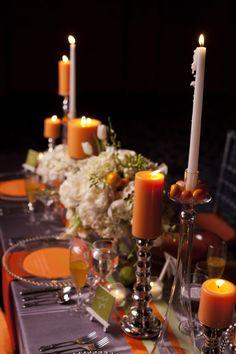 Beautiful orange candles and white flowers. Inspiration from Urbane Montage Events and Cadence Cornelius Photographs |via junebugweddings.com