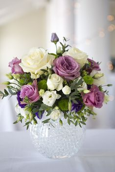 Arrangement of white, pink and purple wedding flowers. - Arrangement of white, pink and purple wedding flowers.