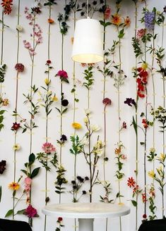 fake flowers to decorate a blank wall.