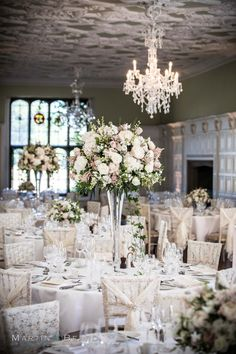 High and low table displays in the long gallery of Hengrave Hall Simple Wedding Table Decorations, Low Wedding Centerpieces, Wedding Vases, Wedding Table Flowers, Floral Centerpieces, Table Centerpieces, Wedding Ideas, Wedding Photos, Purple And Silver Wedding