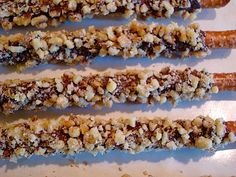 Chocolate covered pretzel rods with many different festive toppings ~T~ I am going to try crushing up valentine M She gives so many ideas. I did them with heath bar toffee bits and every one loved them.