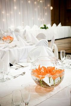 orange centrepiece; but instead of orange, how about some purple or blue flowers? Hmmm