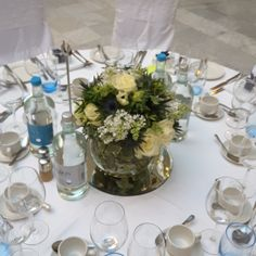White & blue table arrangement in a Goldfish bowl on top of a mirror.