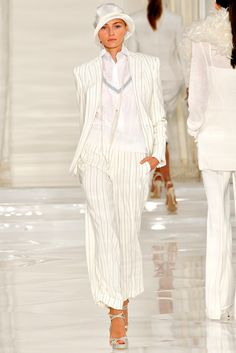 3/1/15 This Ralph Lauren ensemble was inspired by the 1920s. You can see that by the cloche hat which is tilted and covering the forehead. Also the shaping of the outfit is very straight, which was popular look at this time.