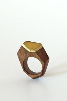 Rich, dark Walnut wood and lustrous brass are combined in an elegant reimagining of gem facet presentation in wood form. Hand carved in Cape Town, South Africa by jeweler Diana James, this gorgeous ri