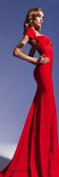Olesya Malinskaya Spring Summer 2013 - red gown.  Watch out because red gowns are a huge up coming trend.  Why go dull with the classic black dress when red dresses like this one are still simple and classy but also fresh, trendy, and eye-catching.