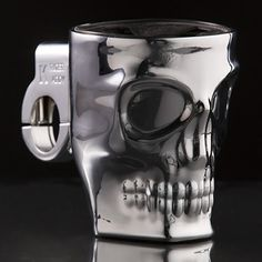 Kruzer Kaddy Chrome Skull Motorcycle Handlebar Cup Holder made of solid chrome with skull design is handlebar mount and holds up to 16 ounce drinks on your motorcycle with locking clamp for 7/8 to 1 1/4 inch handlebars and universal fits most Harley and cruiser style motorcycles.