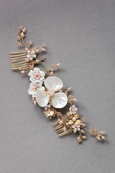 The Magnolia floral bridal headpiece makes a dramatic yet delicate statement, exuding the beauty of the botanicals in a refined and luxurious piece. Handmade with an exquisite attention to detail, this striking piece is perfectly placed above a low set updo. Handcrafted from freshwater pearls in soft blush, Swarovski crystals in soft champagne, Mother of Pearl details and enamel flowers in ivory, the Magnolia is full of unexpected details. Style it with the Rosella chapel veil with blusher…