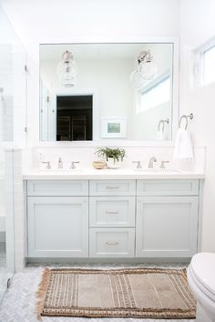 While the kitchen did receive a ton of renovations, Ausland told us she also remodeled the kids' bathroom and the master bath, as well as enlarging it. We love the bright feel of this space and. Bathroom Kids, Bathroom Renos, Bathroom Renovations, Small Bathroom, Bathroom Vanities, Budget Bathroom, Bathroom Cabinets, Bathroom Mirrors, Grey Bathroom Vanity