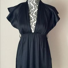 Black Marciano Low-Cut Dress Beautiful silky Marciano Dress! Size XS. Does not come with original belt. Gorgeous condition! Guess by Marciano Dresses Mini