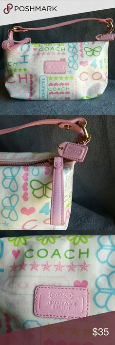 Coach Bandana Laminated pouch/purse An ultra-chic lightweight pouch from Coaches bandana collection. Features multicolored graphics including daisies, butterflies, stars and hearts and Coach logo. Offers pink leather trim accent with a Polish nickel Hardware. Pink leather Coach embossed patch on front with decorative pink hangtag. Interior is fully lined with tan fabric very clean. Please notice arrows indicating slight discoloration on front of bag. Coach Bags Mini Bags