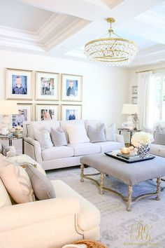 How to Create a Livable + Beautiful Family Room - Randi Garrett Design. Family pictures make a house a home. Glam transitional living room with white couches and touches of brass and gray.
