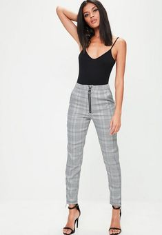 The skinny trousers feature a cigarette style, grey prince of wales check and exposed ring zip detailing to the front and cuffs.