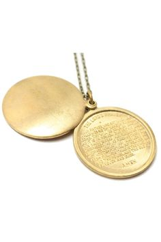 Locket stamped with the Lord's Prayer.