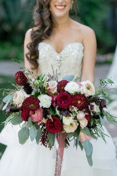 Romantic Ruby Red Bouquet with Greenery | Photo: David Manning Photographer. View More: http://www.insideweddings.com/weddings/interfaith-ceremony-tented-reception-with-romantic-color-palette/885/