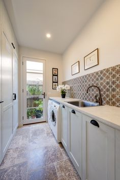 Hand painted joinery, classic tapware in a 'Veccio Organic' finish and warm patterned splashback tiles are the main feature of the laundry. Splashback Tiles, Joinery, Building Design, Kitchens, Laundry, Hand Painted, Organic, Warm, Interior Design