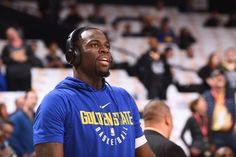 Draymond Green of the Golden State Warriors warms up before the game against the New York Knicks on January 23 2018 at ORACLE Arena in Oakland...