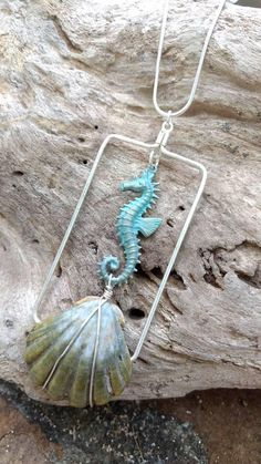 Check out this item in my Etsy shop https://www.etsy.com/listing/531624526/long-hawaiian-sunrise-shell-and-seahorse