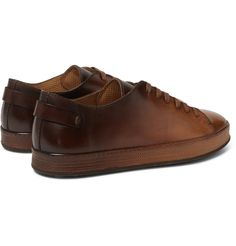 Heritage is of the utmost importance to Italian shoemakers <a href='http://www.mrporter.com/mens/Designers/Santoni'>Santoni</a>. Made from flawless leather, these sneakers are meticulously burnished and polished for a glossy, dégradé finish that graduates from rich tan to cognac. The matching laces are a sleek finishing touch. Show them off to full effect with cuffed or tapered trousers.