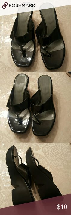Sandals Black nine west wedge sandals, good condition, a little scuffing but not noticeable Nine West Shoes Wedges