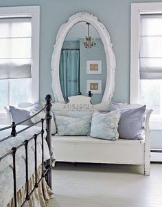 gray and blue bedroom, love the large mirror and vintage bench