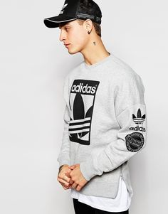 "Sweatshirt by adidas Originals Loop-back sweat Crew neck Signature branding Ribbed trims Side zips Regular fit - true to size Machine wash 70% Cotton, 30% Polyester Our model wears a size Medium and is 185.5cm/6'1"" tall"