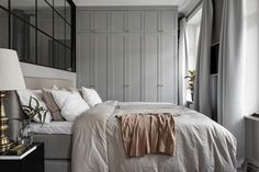 I love this Swedish bedroom inspiration with its grey monochromatic color scheme and simple wall gallery. Scandinavian Apartment, Scandinavian Bedroom, Stylish Bedroom, Modern Bedroom, Home Bedroom, Bedroom Decor, Bedroom Ideas, Bedroom Closets, Bedroom Inspo