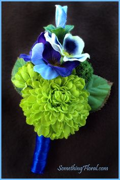 Vibrant blue, green, purple, and white groomsmen boutonniere