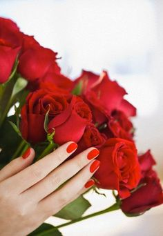 Romantic red roses with matching red nail polish