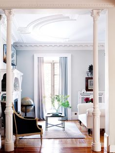 Update classic in Madrid | feminine rustic living room gray blue white molding columns traditional