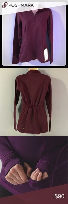 LuluLemon First Mile Half Zip Running top/jacket. Half zip front, single zip pocket in front. Fold over cuffs, hip length. More of a deep purple, as shown in last 2 stock photos. New with tags. lululemon athletica Tops Sweatshirts & Hoodies