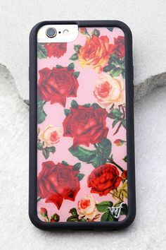 Make sure your phone is as trendy as you are, with the Wildflower Rose Garden Pink Floral Print iPhone 6 and 6s Case! A pink, red, and orange rose print adds a fun, femme touch to this plastic case with a slim profile. Flexible, black rubber sides, raised front lip, and access to all ports. Fits iPhone 6 and 6s. Silver metal logo at front.