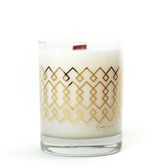 Simply Curated hand crafted the 22K Gold Cocktail Collection soy candle with natural ingredients of warm coconut, sensual Sandalwood, and creamy Shea Butter. The perfect candle to warm up your home. This candle is a 100% soy wax candle and hand poured into a 12 oz. rocks glass. You can enjoy the crackle of the clean burning wooden wick and 75 hours of burn time. Once the candle runs out you can wash out the glass with warm water and you can reuse it as a cocktail glass. Each candle from the…