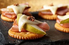 Use RITZ crackers as a substitute for bread with these Open-Face Pear, Ham & Cheese Snacks! They're the perfect way to utilize all those leftovers from your Thanksgiving or Christmas dinner.